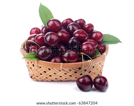 Cherries in a basket isolated on white background