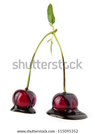 cherries in a chocolate on a white background