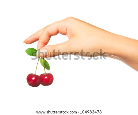 Cherries in a female hand on a white