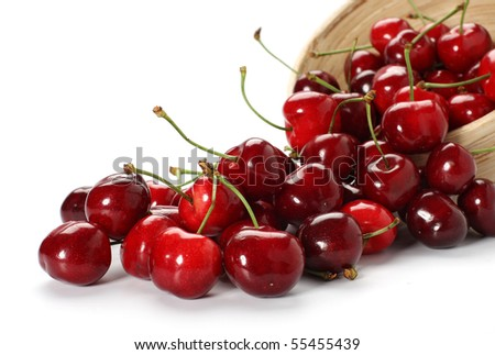 cherries spilling out from the bowl