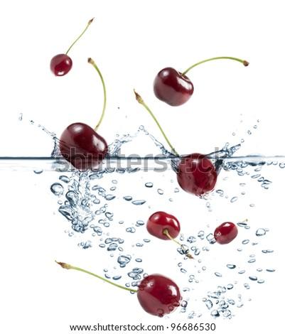 cherries splash in transparent water, on white background
