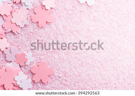 Cherry blossom background image. Cherry blossom pastel pink abstract background fading in to white. Sakura or cherry flower shaped paper cutouts on pink background.
