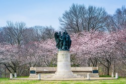Cherry blossoms and statue at Wyman Park, in Charles Village, Baltimore, Maryland.