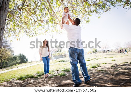 Cherry Blossoms surround a Beautiful young family in Spring time
