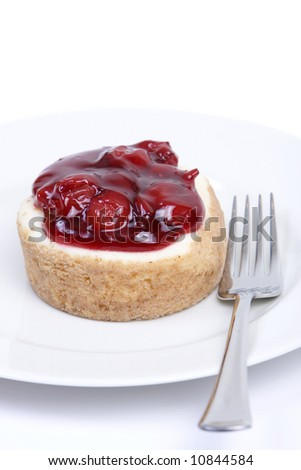 Cherry cheesecake on a white plate with silver fork