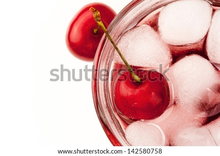 Cherry cocktail with ice on white top view blank
