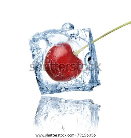 Cherry frozen in ice cube - stock photo