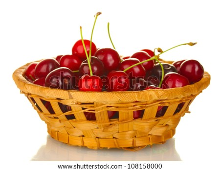 cherry in wicker bowl isolated on white