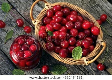 Cherry jam/ cherry  basket /  fresh cherries  background/  top view