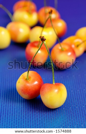 Cherry on blue background