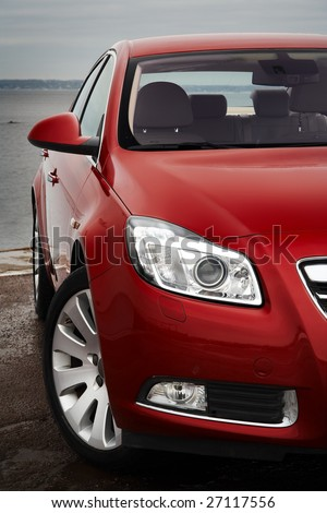 Cherry red car front bumper, light and wheel detail