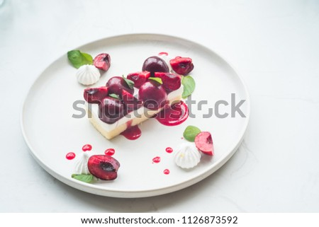 Cherry slice, cherry cake with marble table in background
