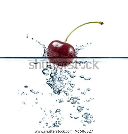 cherry splash in transparent water, on white background