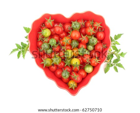 Cherry tomato all ripening phases in heart shaped dish