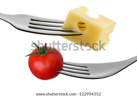 cherry tomato and emmental cheese on a fork against white