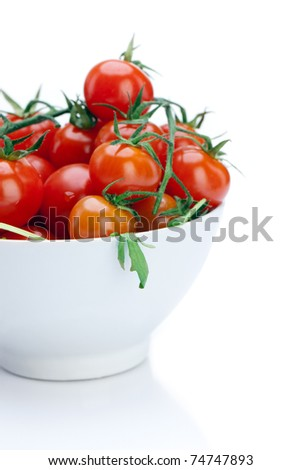 Cherry Tomato in a white bowl isolated on a white background.