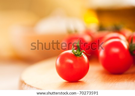 Cherry tomato on a wooden board. Shallow depth of field