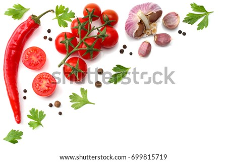cherry tomato, red hot chili pepper, garlic and spices isolated on white background. top view - Shutterstock ID 699815719