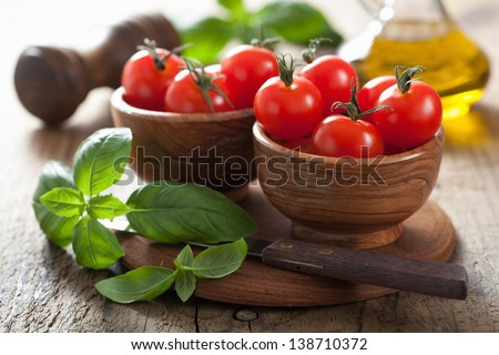 cherry tomatoes and basil - stock photo