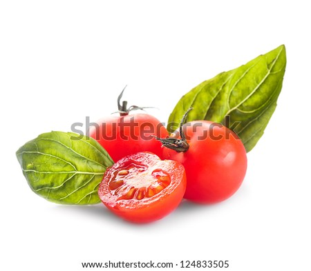 Cherry tomatoes and basil leaves isolated on white