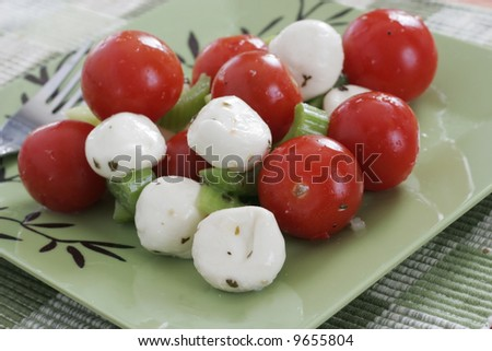 cherry tomatoes, celery and mozzarella cheese balls salad