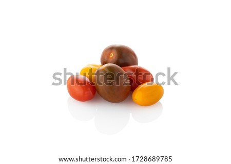 Cherry tomatoes. Colored cherry tomatoes, on a white background. (Tr - kiraz domates) Stok fotoğraf ©