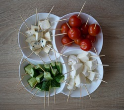 Cherry tomatoes, Cucumbers and Cheese Mocarella (Mozzarella) and Cheese with mold