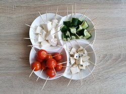 Cherry tomatoes, Cucumbers, Cheese Mocarella (Mozzarella) and Cheese with mold