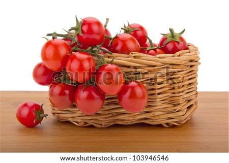 Cherry tomatoes in a basket isolated on white background
