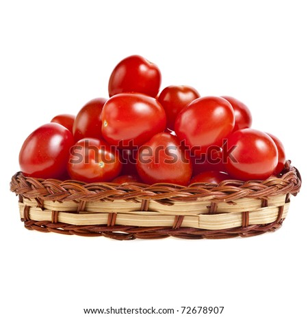 cherry tomatoes in basket on white background - stock photo