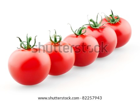 Cherry tomatoes in row isolated on white background. Focus on first tomato.