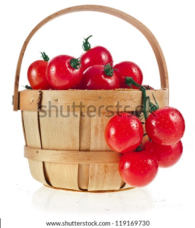 cherry tomatoes in wooden basket on white background