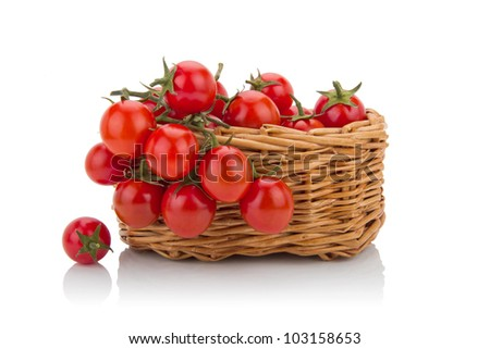 cherry tomatoes isolated  in a basket