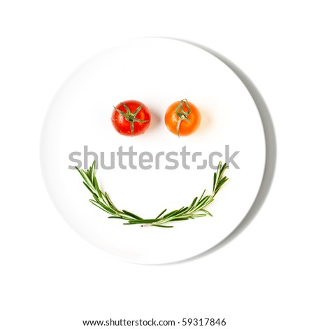cherry tomatoes making smiley face