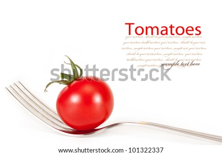 cherry tomatoes on a fork. isolated on a white background