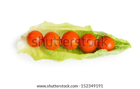 cherry tomatoes on lettuce leaf