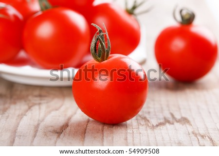 Cherry tomatoes on the wood background