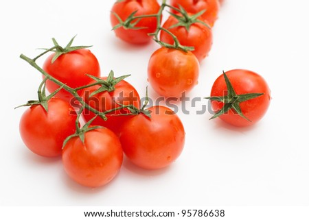 Cherry tomatoes on white background