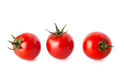 Cherry tomatoes. Three cherry tomatoes isolated on white background