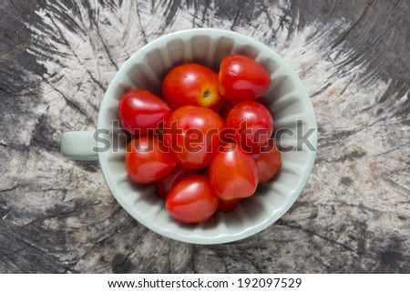 Cherry tomatoes - Top view of cherry tomatoes inside cup on natural background