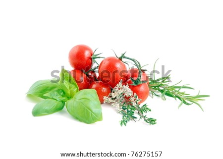 Cherry tomatoes with herbs on white background