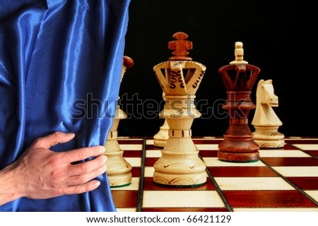 chess and curtain showing strategic business behavior - stock photo