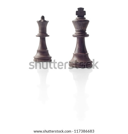 Chess. Black King and Queen out of focus and their shadows reflection on white background. Winner, power, competition or leadership men women concept.