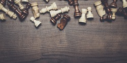 chess board and figures on the wooden background