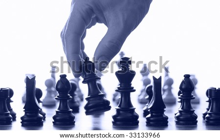 Chess board and hand blue tone