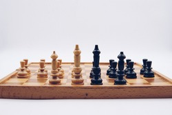 Chess board game concept of strategy ideas. Abstract present real life, Pawns in front line and kings and queens behind them.