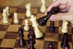 Chess board game, queen takes queen protecting king, encounter difficult situation, business competitive concept, copy space