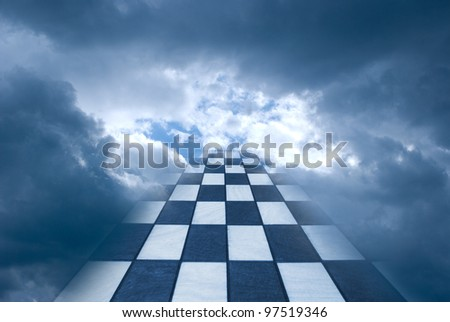 Chess board on a background of the dark blue sky.
