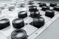 Chess board with checkers. Hobby. checkers on the playing field. Board games. Black and white checkers.
