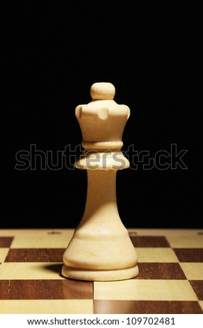 Chess board with chess piece isolated on black